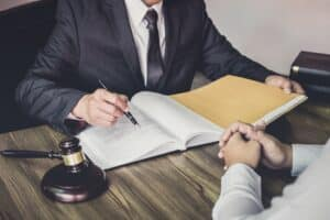 IT businessman and lawyer or judge working together